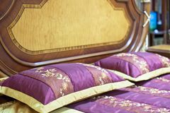 Part of a double bed with decorative headboard Royalty Free Stock Image