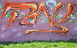 Part drawing graffiti - colorful wall with signs Stock Photography