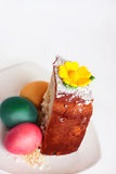 Part of the  Easter cake. Part of Easter cakes and painted eggs on three white Royalty Free Stock Image