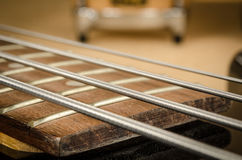 Part of electric bass. Part of black body electric bass royalty free stock images