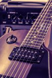 Part electric guitar and classic amplifier on a dark background.  Royalty Free Stock Photo