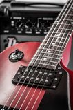 Part electric guitar and classic amplifier on a dark background.  Royalty Free Stock Photos