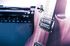 Part electric guitar and classic amplifier on a dark background.  Stock Photography