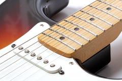 Part of electric guitar. Close-up, studio shot Stock Photography