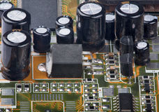 Part of electrical board with capacitors Royalty Free Stock Images