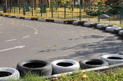 Part of an empty road for karting in the autumn park. On sun day royalty free stock image