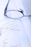 Part of eyeglasses and paper Royalty Free Stock Photos