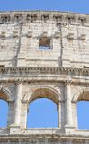 Part of a facade of the Colosseum with an arch royalty free stock photo
