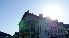 Part of the facade of a house in modern style and sun rays.  stock video