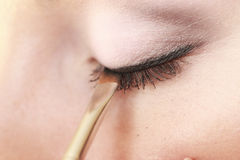 Part of face female eye makeup applying with brush Royalty Free Stock Images