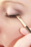 Part of face female eye makeup applying with brush Stock Photos