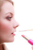 Part of face. Woman applying red lipstick with brush Stock Images