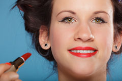 Part of face. Woman applying red lipstick Stock Photo
