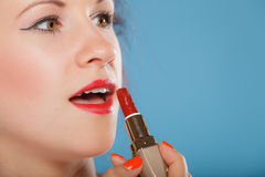 Part of face. Woman applying red lipstick Stock Photos