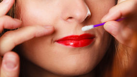 Part of face. Woman applying red lipstick Royalty Free Stock Photo