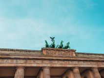Bottom view of Brandenburg Gate in Berlin with blue sky behind stock images