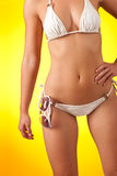 Part of female body with bikini and sunglasses Stock Photography