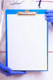 Part female body in lab coat. Doctor nurse with blank clipboard stock images