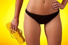 Part of female body wearing black bikini Stock Photos