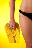 Part of female body wearing black bikini Royalty Free Stock Photography