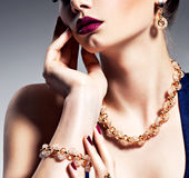 Part of female face with beautiful golden jewelry Stock Images