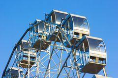 Part of the Ferris wheel against the blue sky Royalty Free Stock Photos