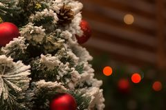 New Year`s background. Part Festive Christmas tree in the foreground. royalty free stock image