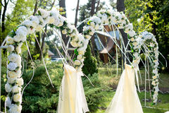 Part of the festive decor, floral arrangement. Detail of wedding arch. Part of the festive decor, floral arrangement. Detail of a wedding arch Stock Image