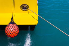 Part of fishing boat with red buoy Stock Images