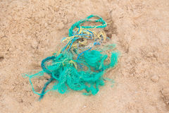 Part of the fishing net on the sandy beach. Stock Images
