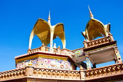 A Part of five buddha on the blue sky. A Part of  five buddha on the blue sky at Wat Phasornkaew in Thailand Stock Photo