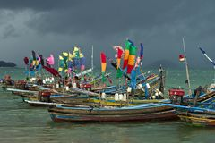 Part of a fleet of colorful muslim fishing boats stock image