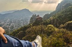 Part of the foot of a man that observes from the top of Tepozteco hill in Tepoztlan. Beautiful mountainous view. Tepozteco hill. Archaeological site located in stock photos