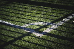 Part of the football field with a marking and a shade from the sun
