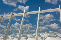 Part of the football stadium on a sky with clouds Royalty Free Stock Image