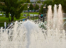 Part fountain with people background Stock Image