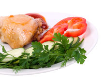 Part of the fried chicken with green-stuffs. On a white dish Royalty Free Stock Photo