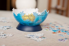 Part of the globe collected from puzzle Stock Image