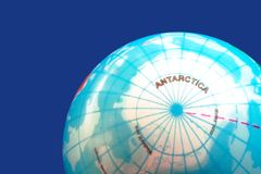 Part of a globe showing the Antarctica and the South Pole. Part of a globe on dark blue background showing the Antarctica and the South Pole stock images