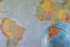 Part of a globe with map of India with blurred map as background Royalty Free Stock Photography