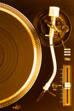 Part of golden dj turntable with tonearm, top view Stock Photography