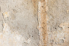 Part of the grange crumbling plaster on the old wall. Royalty Free Stock Image