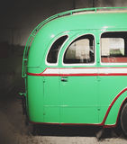 Part of green old retro bus. Back door. Royalty Free Stock Image