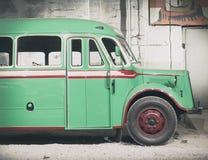 Part of green old retro bus. Front door and wheel. Stock Photos