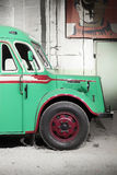 Part of green old retro bus. Front wheel. Stock Image