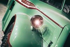 Part of green old retro bus. Headlight Stock Photos