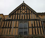 Part of a half timber framed building with ornate carvings on the facia boards stock image