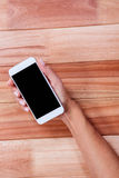 Part of hand holing smartphone Stock Photo