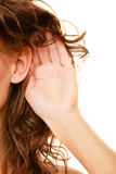 Part of head woman with hand to ear listening Stock Photo
