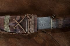 Part of hidden in the stick Real japanese samurai sword on leather stock photography